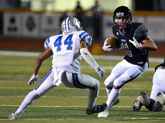 Onate's Jayden Diaz runs up the middle against the
