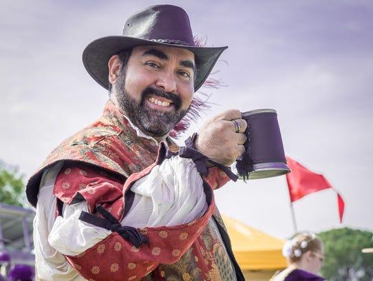 A thirsty reveler enjoys a pint of beer at a recent