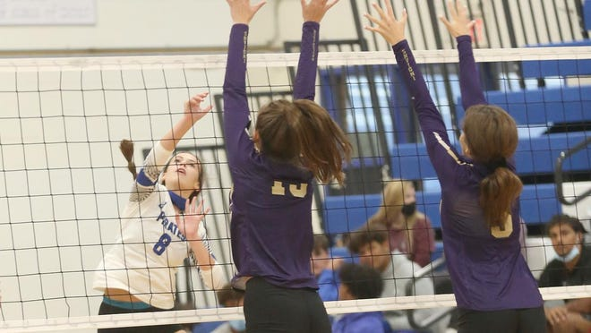 Boonville sophomore hitter Genae Hodge hits the ball through two Hallsville players in the first set Thursday night in Tri-County Conference action at the Windsor gymnasium. The Lady Pirates improved to 5-4 overall and 2-2 in the TCC by beating Hallsville in three straight sets 25-18, 25-18 and 25-22.