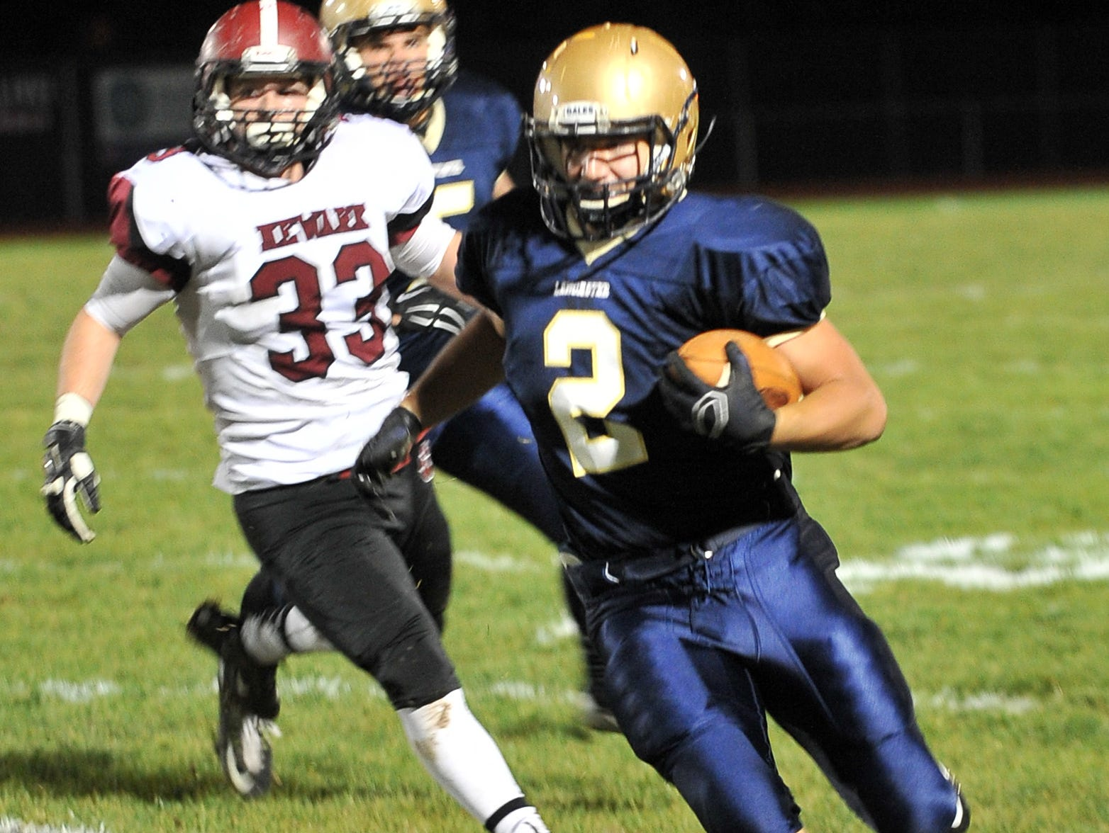 Lancaster's Shea Goss runs the ball early in first quarter of the the Golden Gales game Friday night against Newark at Fulton Field in Lancaster. Lancaster won the game 38-7.
