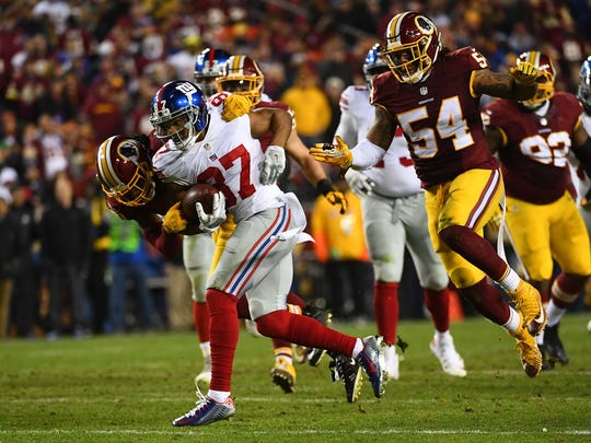 New York Giants wide receiver Sterling Shepard (87) is tackled by Washington Redskins cornerback Greg Toler (20) during the second half at FedEx Field.