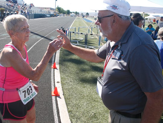 Track official Gerard Collet hands Dottie Gray the