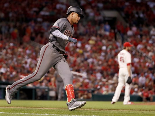 Arizona Diamondbacks' Ketel Marte, left, rounds the bases after hitting a two-run home run of St. Louis Cardinals relief pitcher Kevin Siegrist during the eighth inning of a baseball game Saturday, July 29, 2017, in St. Louis. (AP Photo/Jeff Roberson)