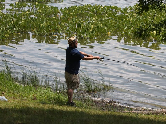 A man fishes at Rockland Lake.