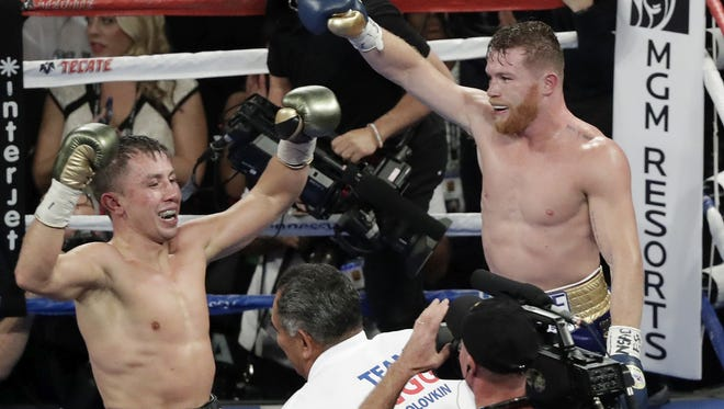 Canelo Alvarez, right, and Gennady Golovkin celebrate following a middleweight title fight Sunday, Sept. 17, 2017, in Las Vegas. The fight was called a draw. (AP Photo/Isaac Brekken)