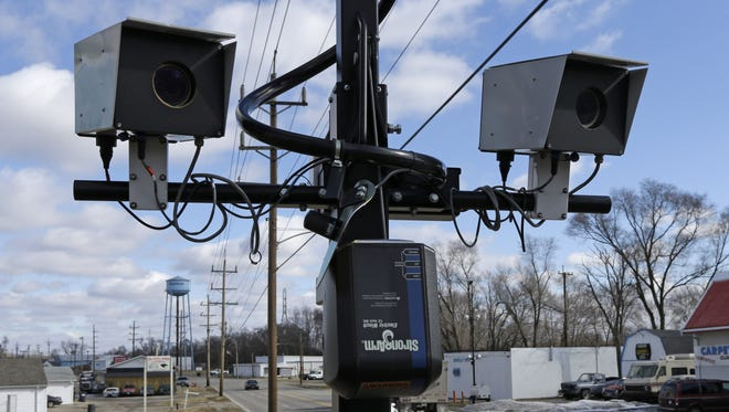 This file photo shows speed cameras aimed at U.S. 127 in New Miami, Ohio.