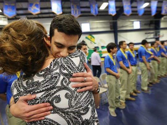Cathedral High School senior Cameron Paredes received a big congratulatory hug from his mother, Rowena Apodaca, at the conclusion of a ceremony where 14 of the school's seniors were honored Monday for their selection as Gates Millenium Scholars. The Gates Millennium Scholarships were created in 1999 with grants from the Bill and Melinda Gates Foundation. It seeks to promote academic excellence  by providing outstanding minority students with scholarships for use at their college of choice in the discipline they select. The scholarship completes unmet costs of higher education while enablng leadership development programs. The selected students were from a national applicant pool who demonstrated financial need, highest academic standards, community service and leadership qualities.