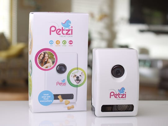 Petzi remote camera, communicator and treat dispenser lets you see, snap, treat and speak to your pet from anywhere, anytime.