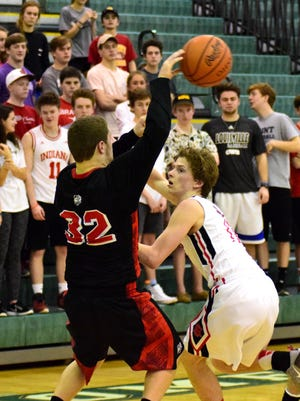 Matteo Fiore (right) of Indian Hill forces a turnover playing tight defense against New Richmond's Frankie Taullbee (32),  Feb. 20, 2016.