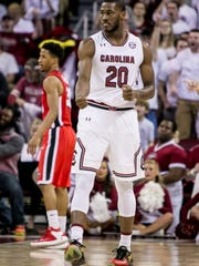 Feb 4, 2017; Columbia, SC, USA; South Carolina Gamecocks guard Justin McKie (20) celebrates a three pointer against the Georgia Bulldogs in the first half at Colonial Life Arena. Mandatory Credit: Jeff Blake-USA TODAY Sports