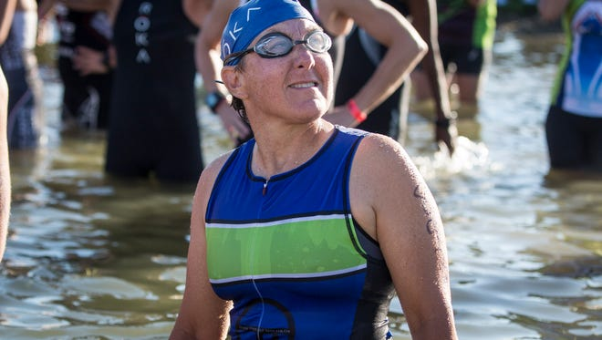 Amy Fletcher prepares to take on another Ironman 70.3 in Muncie Saturday morning after recovering from a serious bicycle accident last Memorial Day. Fletcher suffered a level two head injury, a broken eye socket, broken femur and broken cheekbone.