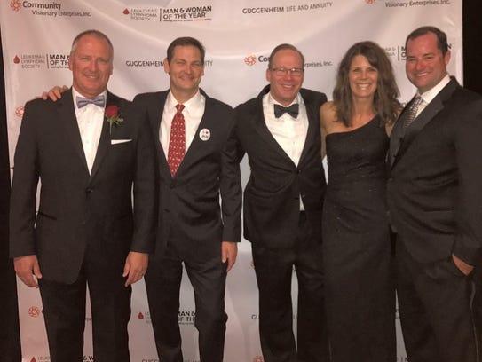 From left, 2017 Man of the Year winner Rick Blaiklock,