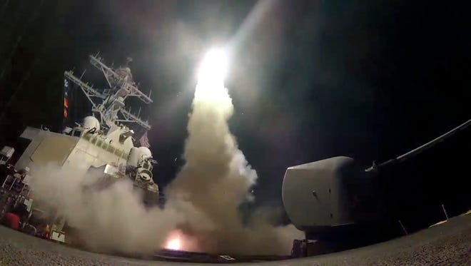 In this image from video provided by the U.S. Navy, the guided-missile destroyer USS Porter launches a tomahawk land attack missile in the Mediterranean Sea, Friday. The United States blasted a Syrian air base with a barrage of cruise missiles in fiery retaliation for this week's gruesome chemical weapons attack against civilians.  (Mass Communication Specialist 3rd Class Ford Williams/U.S. Navy via AP)