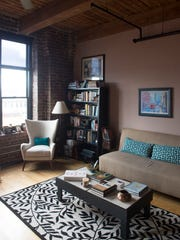 This corner of Kim's living room combines different neutral shades with teal, one of her favorite accent colors. Her father made the bookshelves and coffee table.