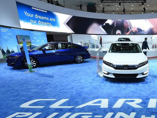 The Honda Clarity plug-in hybrid cars on display during