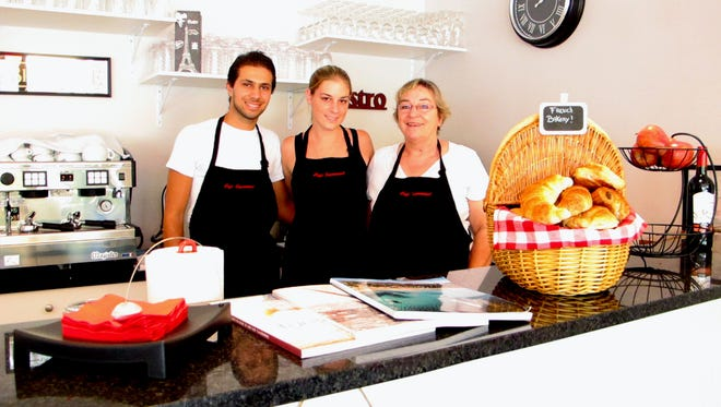 Bernadette Georges, right, co-owns the new Café Gourmand in North Naples with her daughter Dominique Dietl and son-in-law Sam Khanfri.