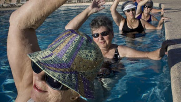 In 2008, Shirley Burt-Overli of Wisconsin exercises during a water aerobics class at Good Life RV Resort in Mesa.