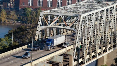 The Brent Spence Bridge spans the Ohio River between Ohio and Kentucky. Ohio Gov. John Kasich recently signed into law a bill that will allow for tolls to be collected electronically if a new bridge is ever built.