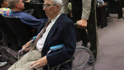 A bailiff wheels Malcolm Paterson out of an Indio courtroom following Paterson's appearance on June 25. The 83-year-old is accused of driving under the influence during a crash last fall that injured 10-year-old student Adrian Grajeda.