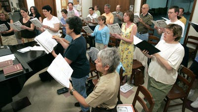 The CoroAllegro chorale, led by director Jack Burnam, rehearses in 2007.