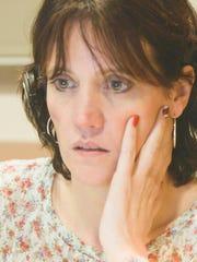 VA crisis hotline staffer Maureen is shown in the 2013