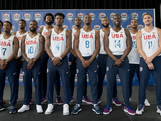 The U.S. men's Olympic basketball team poses for a photo with head coach Mike Krzyzewski, left, and managing director Jerry Colangelo, right, during a news conference Monday, June 27, 2016, in New York. (AP Photo/Mary Altaffer)
