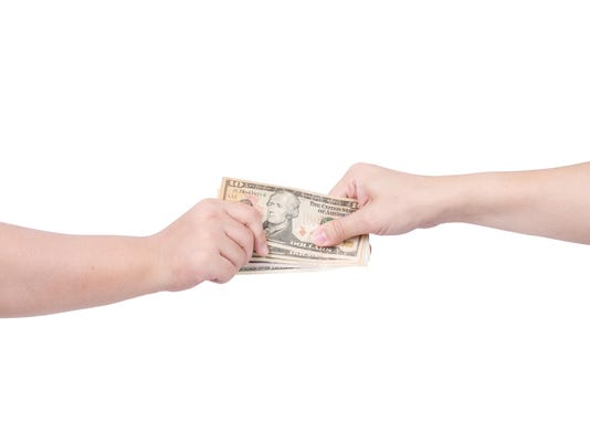 Hand handing over money to another hand isolated on white