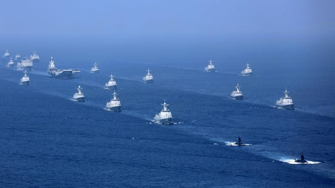 China's Liaoning aircraft carrier is accompanied by navy frigates and submarines conducting an exercises in the South China Sea in 2018.