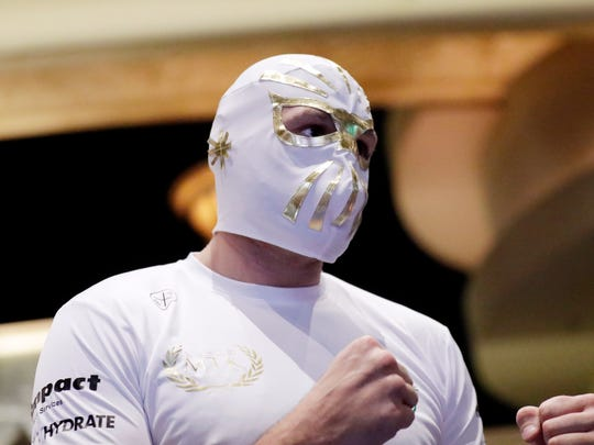 Tyson Fury wears a mask while attending an open workout Tuesday in Las Vegas. Fury will face Otto Wallin in a heavyweight match Saturday.