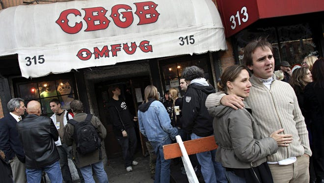 CBGBs fans gather outside of the iconic New York club to attend its final concert on Sunday, Oct. 15, 2006, in New York. A homeless advocacy group, which owns the property, is not renewing CBGBs lease. It expired in August 2005.
