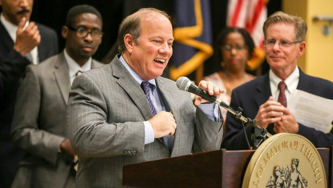 Judge Steven Rhodes, DPSCD Transition Manager, looks on as Detroit Mayor Mike Duggan speaks during a press conference to give the public an update on the progress being made to address the repair and maintenance of Detroit Public Schools Community District buildings held at Bates Academy in Detroit on Monday, Aug. 29, 2016.