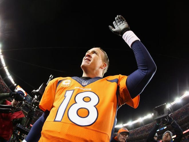 Peyton Manning #18 of the Denver Broncos celebrates their 24 to 17 win over the San Diego Chargers during the AFC Divisional Playoff Game at Sports Authority Field at Mile High on January 12, 2014 in Denver, Colorado.