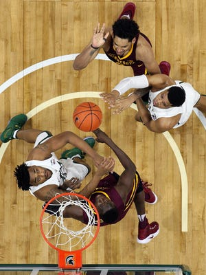 Michigan State's Nick Ward, left, and Alvin Ellis, right, battle for a rebound against Minnesota on Jan. 11 in East Lansing. The Spartans won that game, 65-47, sweeping the regular-season series for two of MSU's signature wins thus far.