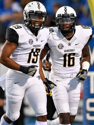 "Vanderbilt wide receiver C.J. Duncan (19) and Vanderbilt wide receiver Kalija Lipscomb (16) celebrate Lipscomb's touchdown early in the first half of an NCAA college football game against Middle Tennessee State at Johnny ""Red"" Floyd Stadium in Murfreesboro, Tenn., Saturday, Sept. 2, 2017."