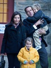 Then-Attorney General Beau Biden and his wife, Hallie Biden, walk with their children, Natalie and Hunter, after voting on Nov. 2, 2010.