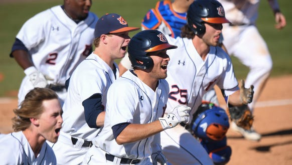 Auburn baseball players celebrate the walk-off win