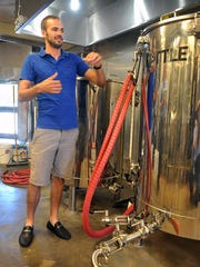 Daniel Anderson, co-owner of Sidecar Brewing, said