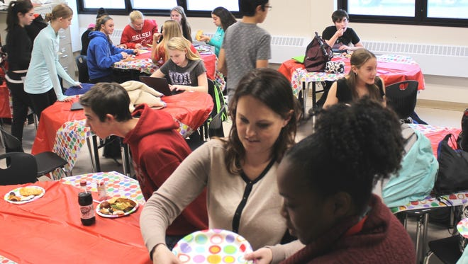 Delsea Regional High School English 1 Honors students' explored various cultures by studying their art, fashion, traditions, values, societal norms and food.