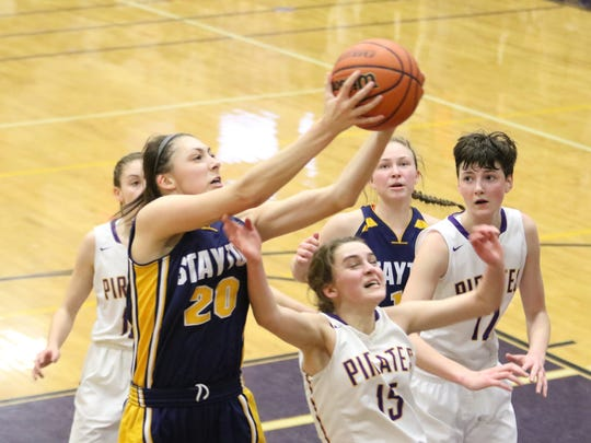 Stayton's Alexa Bender (20) brings down a rebound over Marshfield defenders on Saturday, March 4, 2017.