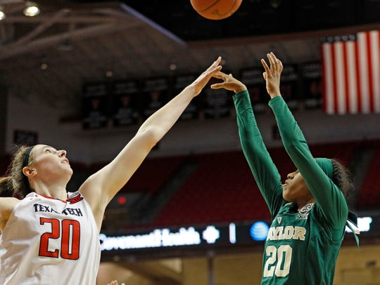 Baylor's Juicy Landrum (20) shoots the ball over Texas