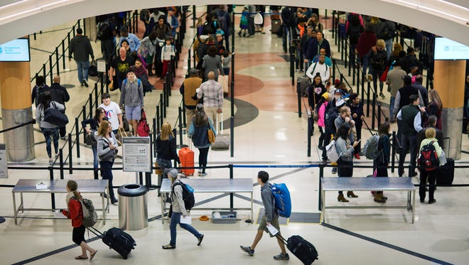 In this Nov. 25, 2015 file photo, travelers wait to go through a security checkpoint at Hartsfield–Jackson Atlanta International Airport in Atlanta. Republican leaders are lauding an aviation policy bill before the Senate as the most passenger friendly in years, but there are limits to friendship. (AP Photo/David Goldman, File)