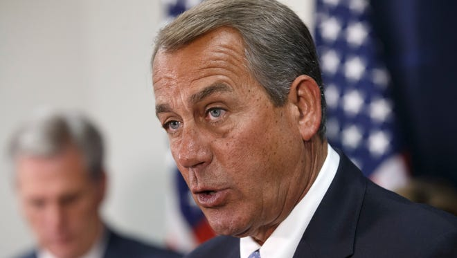 House Speaker John Boehner (right), of Ohio, joined by House Majority Leader Kevin McCarthy of Calif. meets with reporters on Capitol Hill in Washington on Dec. 2, 2014, following a House Republican caucus meeting.