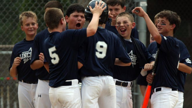 Dimetri Forand, #9 Lincroft, is greeted by teammates after hitting a solo home run against Clark in a 12 year old division NJ Section 3 Little League Tournament game at the Manchester Little League Complex Sunday, July 19, 2015. Jody Somers / For The Asbury Park Press