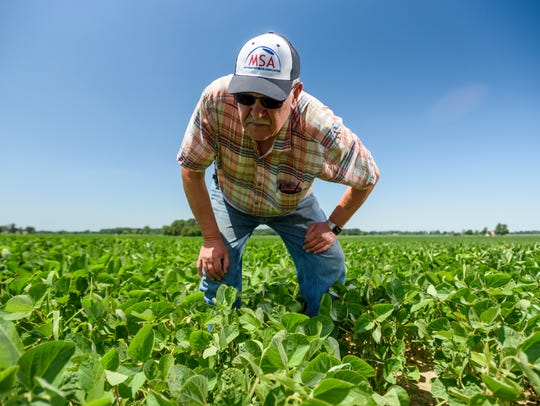 Farmer Dave Williams, a fifth generation farmer, stands