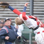 Seton Catholic catcher Trey Bartkus makes a play for a foul ball during Monday's Class A Sectional 56 final at McBride Stadium.