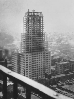The Sterick Building at 8 North Third Street is shown in this undated construction photograph.  Architect Wyatt C. Hedrick's father-in-law, R.E. Sterling, financed the building and the name of the building became a combination of their names.  When it was finished in 1930, the 365 foot tall, twenty-nine story structure became the tallest building, not just in the city, but also in the South.   In 1947, the nine-foot cast-stone Gothic spires had to be removed from the thirteenth, twenty-eighth and twenty-ninth floors, because repeated lightning strikes had split them.  The original color was the light gray of the building's limestone and granite stonework and of the cast-concrete panels that covered most of its upper floors.  It was painted for the first time in the sixties, and in 1982 it was sandblasted and painted the present pale yellow with dark brown and maroon trim.  The roof was originally green.