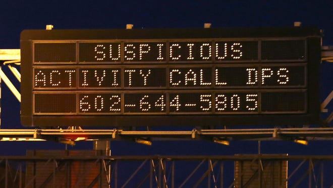 A sign along eastbound Interstate 10 near U.S. 60 urges drivers to report suspicious activity Tuesday, Sept. 8, 2015, in Phoenix.
