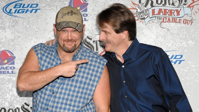 Comedian and roastee Larry the Cable Guy, left, and comedian Jeff Foxworthy pose on the press line at his Comedy Central Roast at the Warner Bros. studio lot in Burbank, Calif. on Sunday, March 1, 2009. (AP Photo/Dan Steinberg)