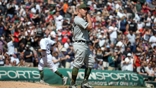 Tigers pitcher Jordan Zimmermann reacts while White Sox third baseman Todd Frazier circles the bases with a two-run home run in the fifth inning of the Tigers' 7-3 loss Sunday, May 28, 2017 in Chicago.