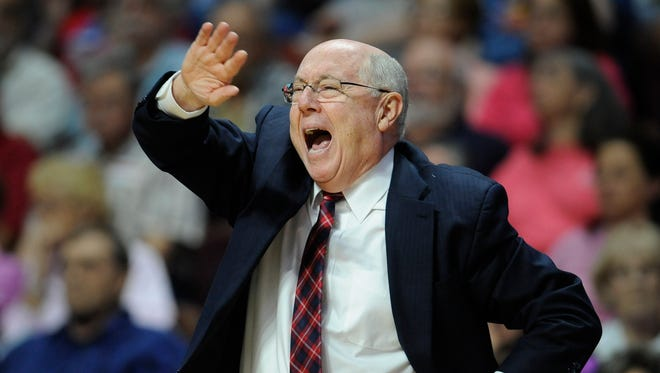 """In this June 14, 2016, file photo, Washington Mystics head coach Mike Thibault calls out to officials during the first half of a WNBA basketball game against the Connecticut Sun, in Uncasville, Conn. The WNBA is in its second year of a new playoff format that takes the top eight teams regardless of conference and puts them in the postseason, diminishing the value of the Eastern and Western Conferences.  That doesn't mean that coaches aren't still interested in coming in first in their respective conferences.  """"Sure it means something still,"""" Washington coach Mike Thibault said."""
